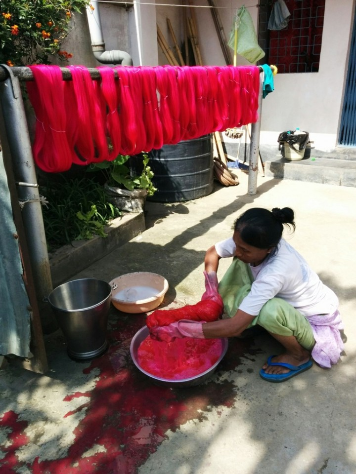 A woman applies dye
